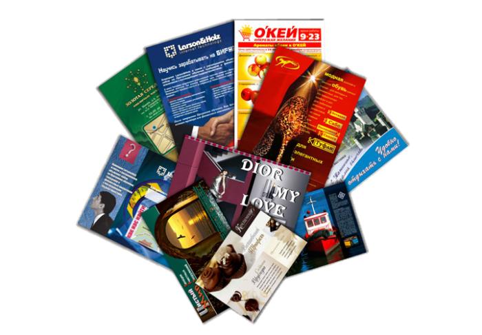На фото продукция из офсетной бумаги: каталоги, календари, глянцевые журналы